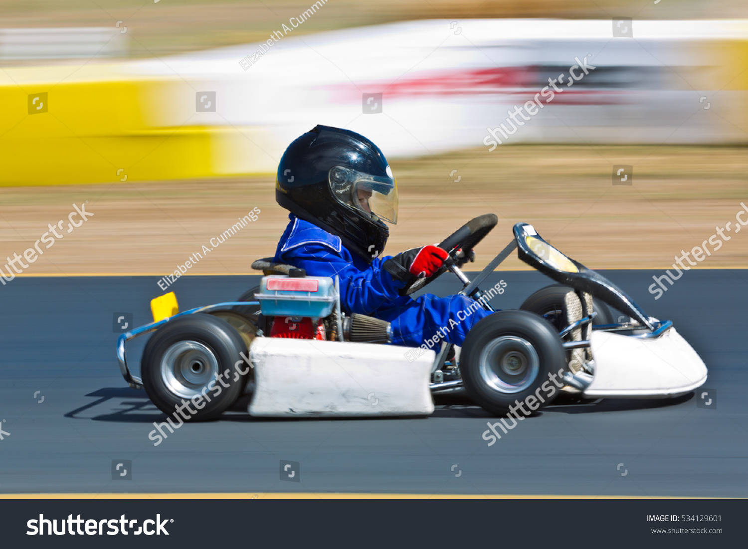 Young Kid Racing Go Cart Around Stock Photo 534129601 - Shutterstock