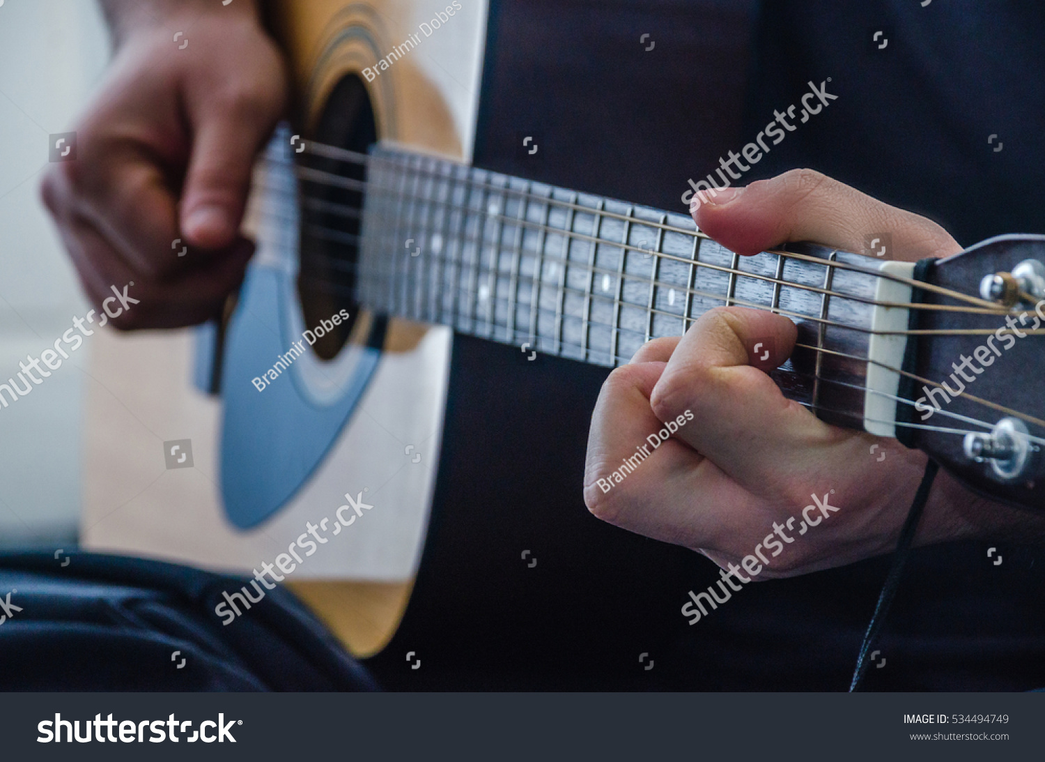 Playing Chord On Yellow Acoustic Guitar Stock Photo Edit Now