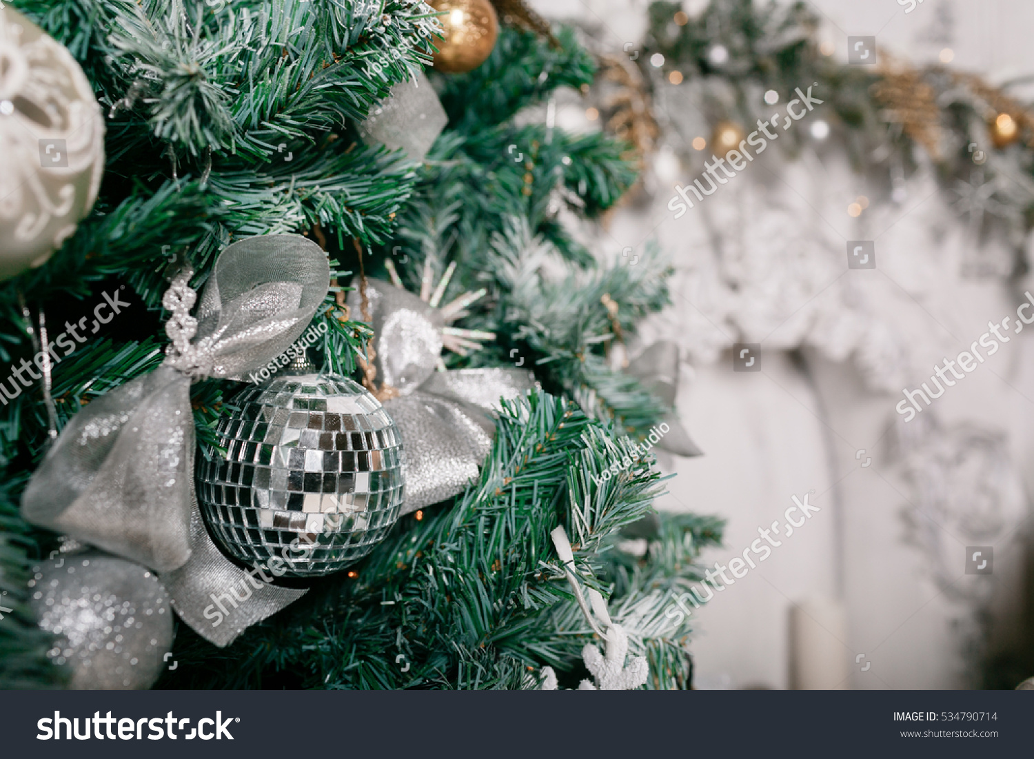 Decorative disco ball close up. decorated christmas tree on blurred