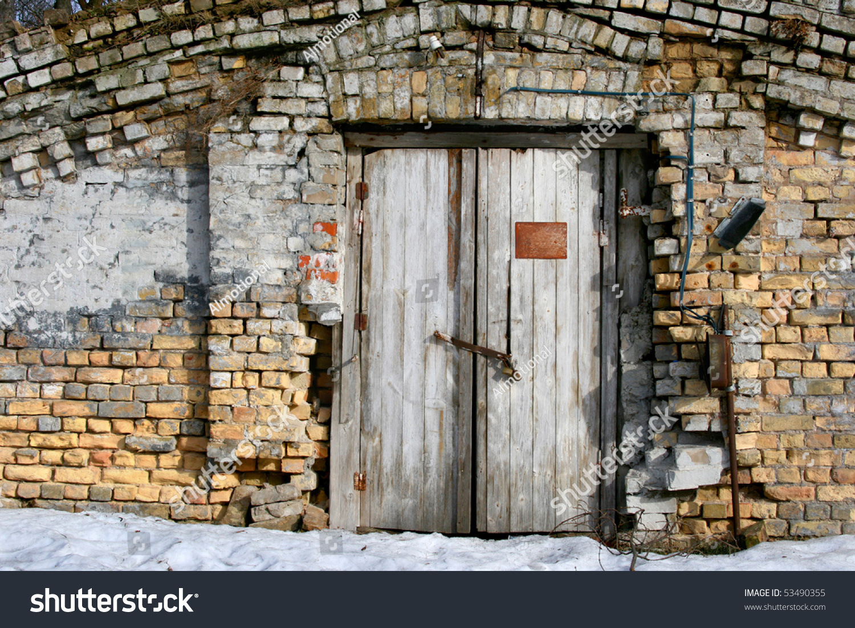 Vintage old door with brick wall front view of the - Wall in front of main door ...