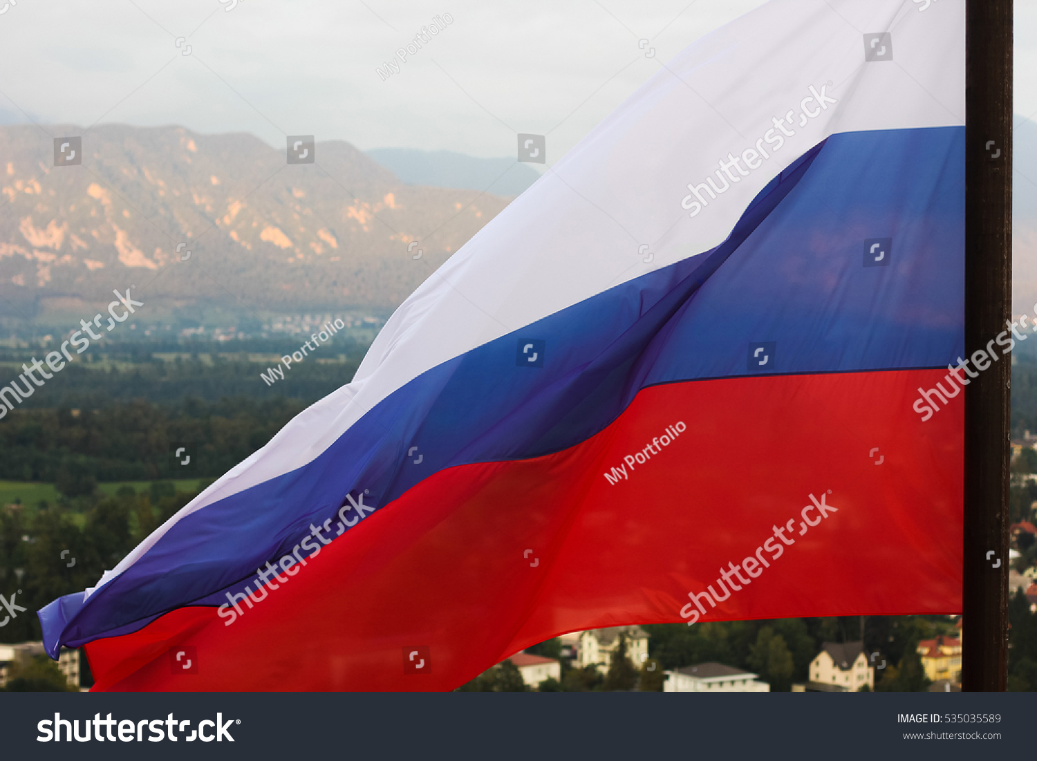 russian flag waving wind on background stock photo 535035589