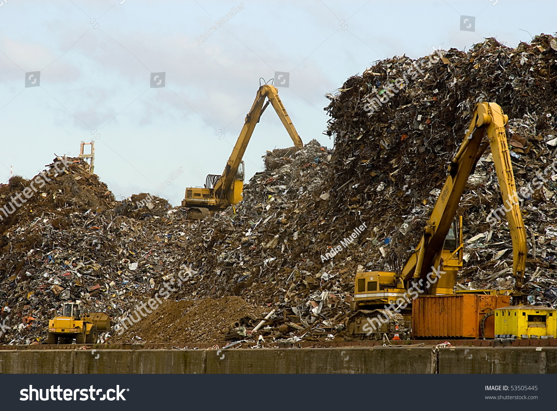 excavators works on a garbage dump stock photo 53505445 shutterstock. Black Bedroom Furniture Sets. Home Design Ideas