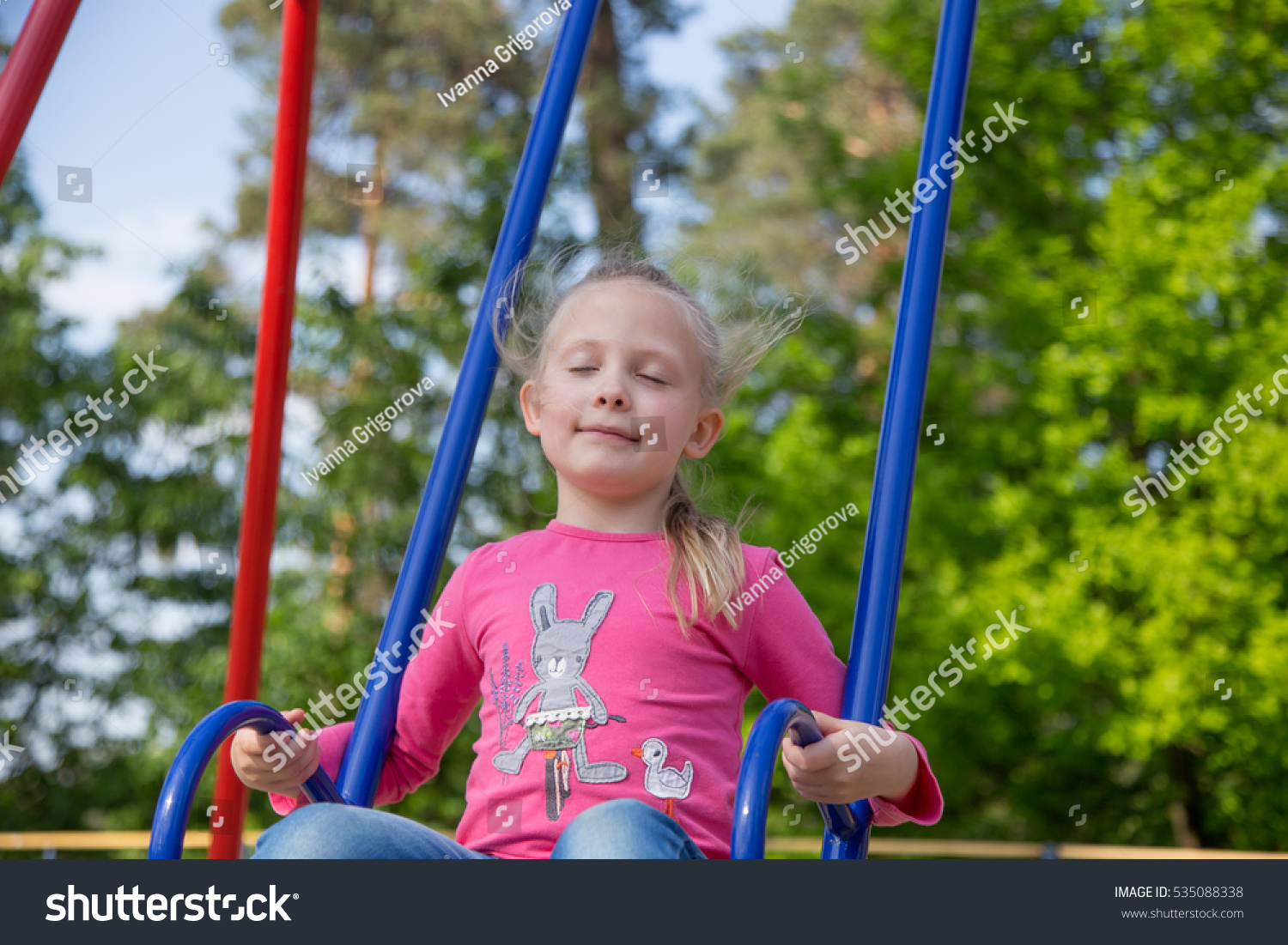 Little girl on playground child playing stock photo for Childrens play yard