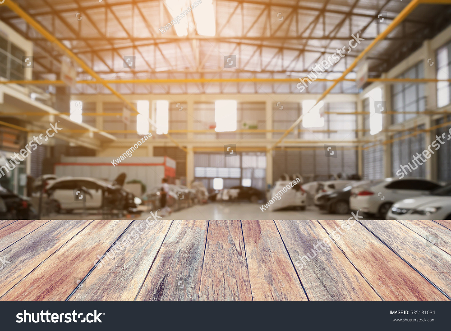 Wood table top with Car repair service centre interior blurred background   For create montage auto. Wood Table Top Car Repair Service Stock Photo 535131034   Shutterstock