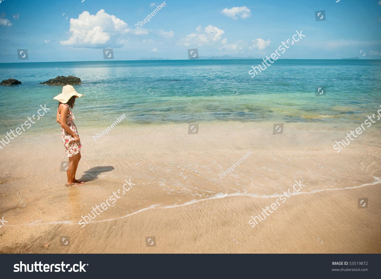 Girl Standing Alone On Beach Stock - 637.5KB
