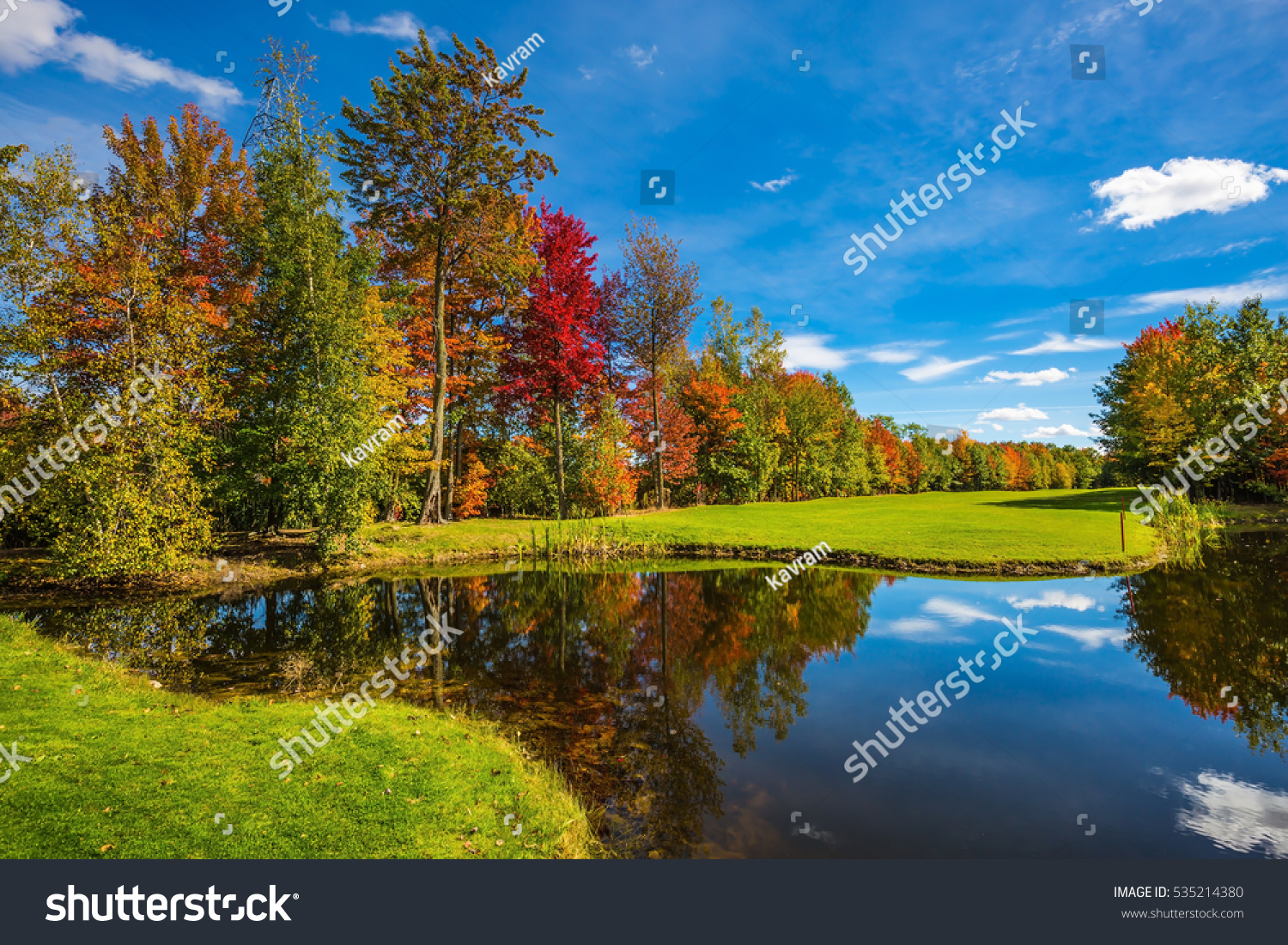 Golf Club French Canada Red orange and green autumn foliage is reflected to clear water of the lake Park of fantastic beauty Concept of Golf tourism