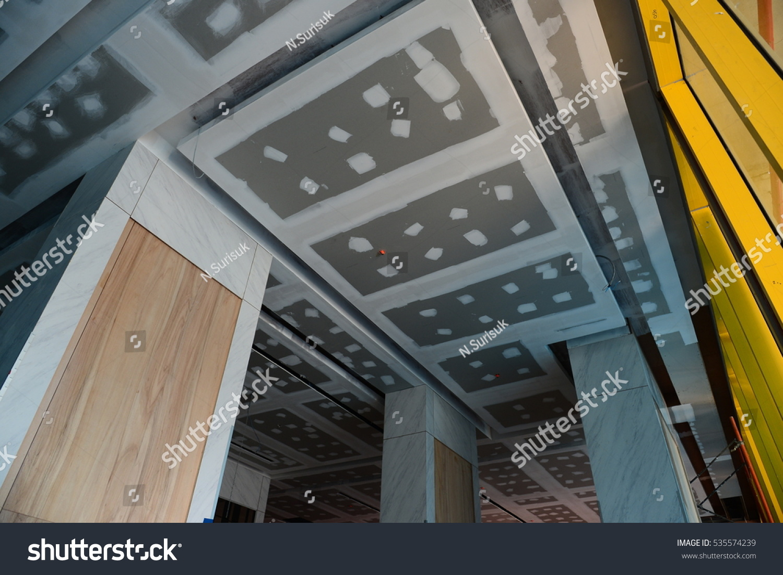Install ceiling tiles gypsum board condominium construction stock install ceiling tiles gypsum board condominium construction in thailand dailygadgetfo Image collections