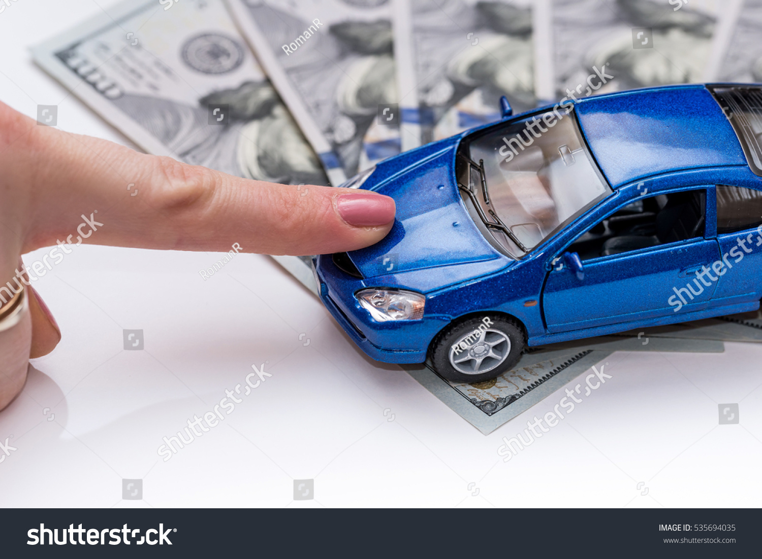 Hand Blue Toy Car Money Isolated Stock Photo Edit Now 535694035