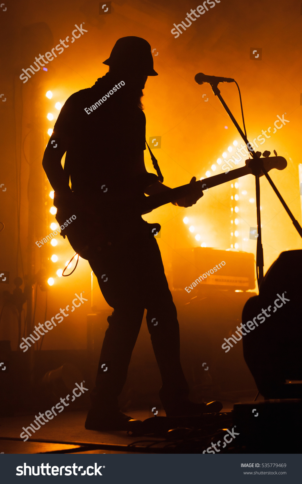 Music Themed Living Room Decor: Silhouette Bass Electric Guitar Player On Stock Photo