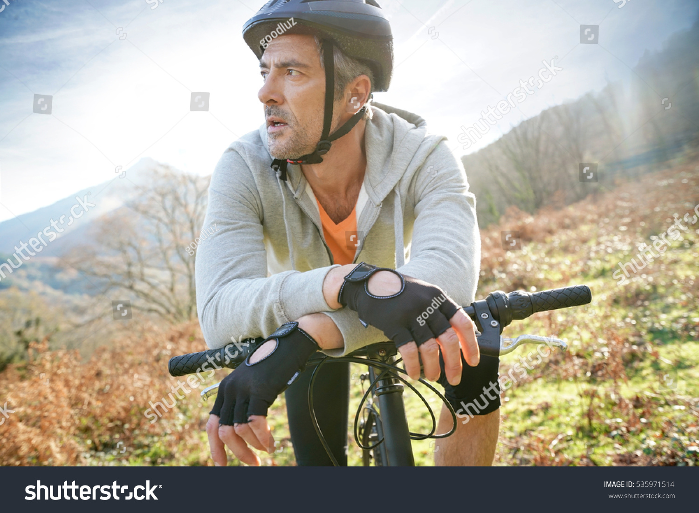 mature man riding bike mountain stock photo 535971514 - shutterstock