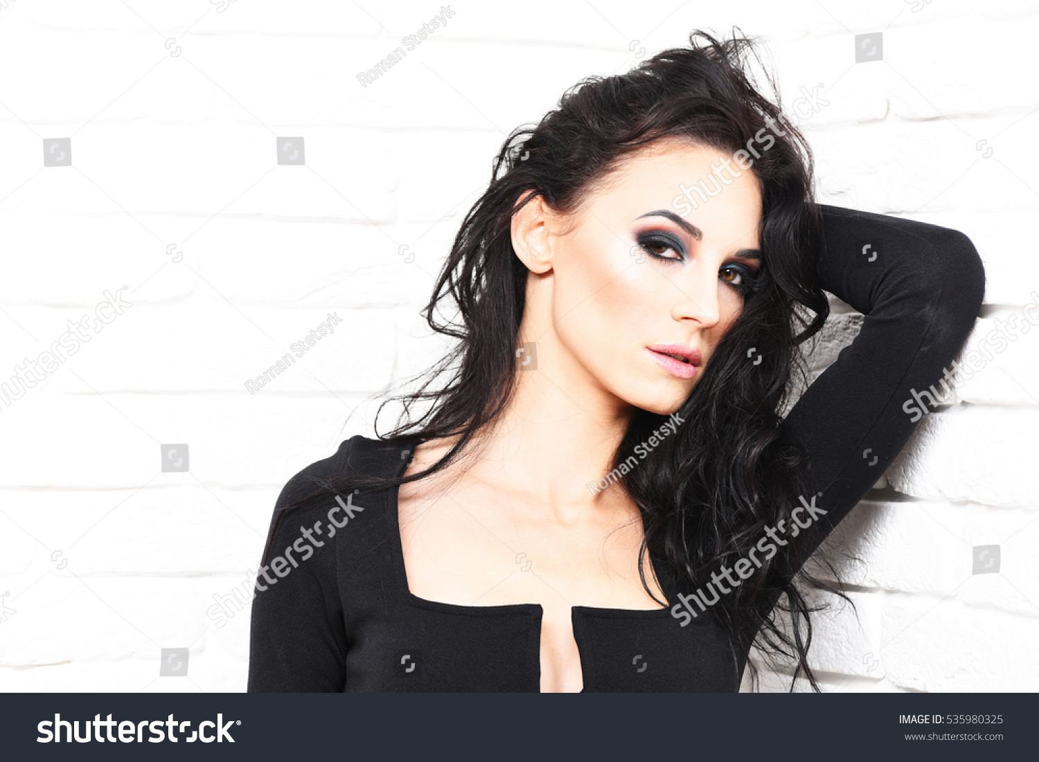pretty cute sexy girl or beautiful woman with fashion makeup on serious face  and curly long 68bb7e48f