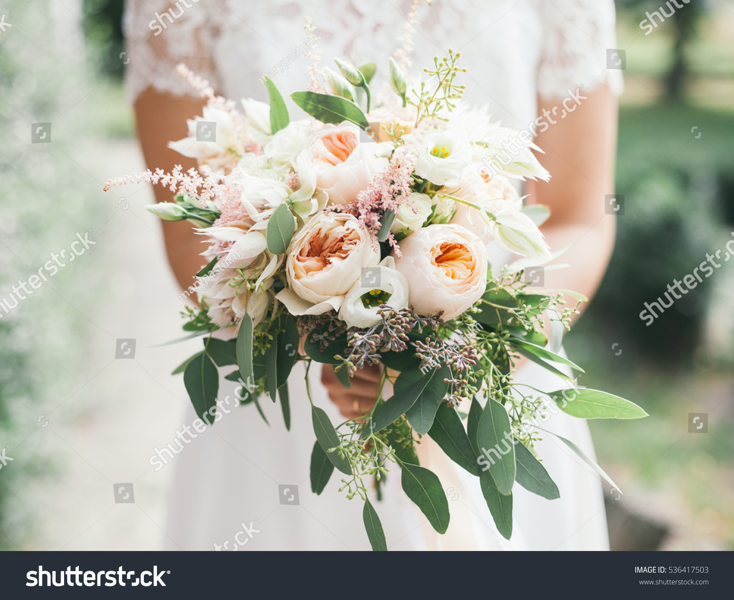 wedding bouquet in bride's hands, david austin