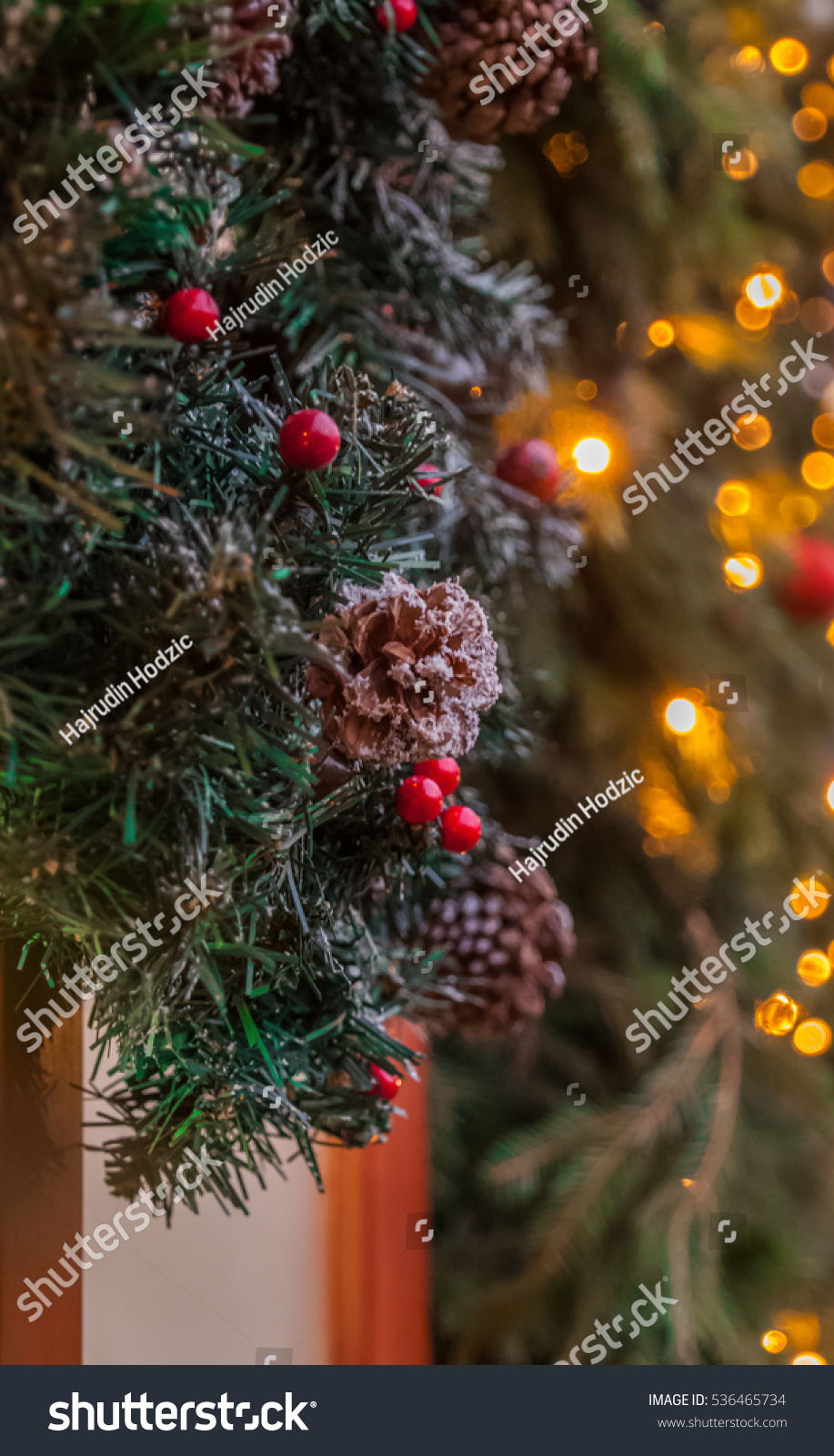 Christmas holiday small red balls decoration on a pine for Red and yellow christmas tree
