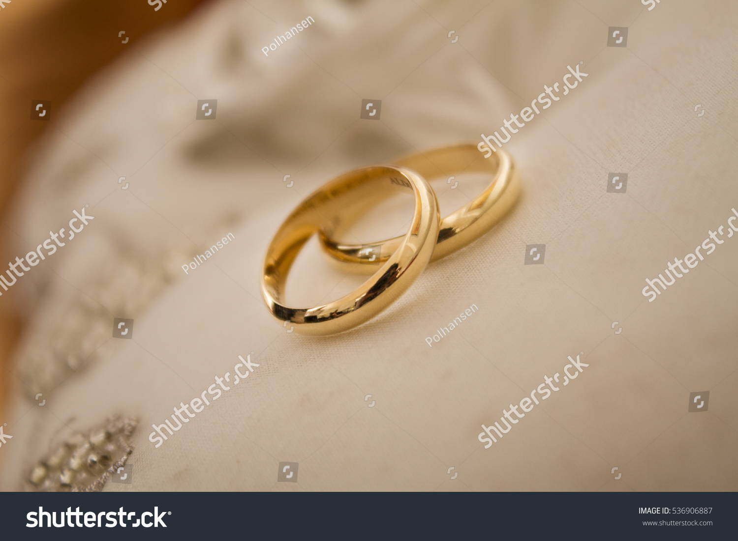 Gold Wedding Rings On A White Cloth Ez Canvas