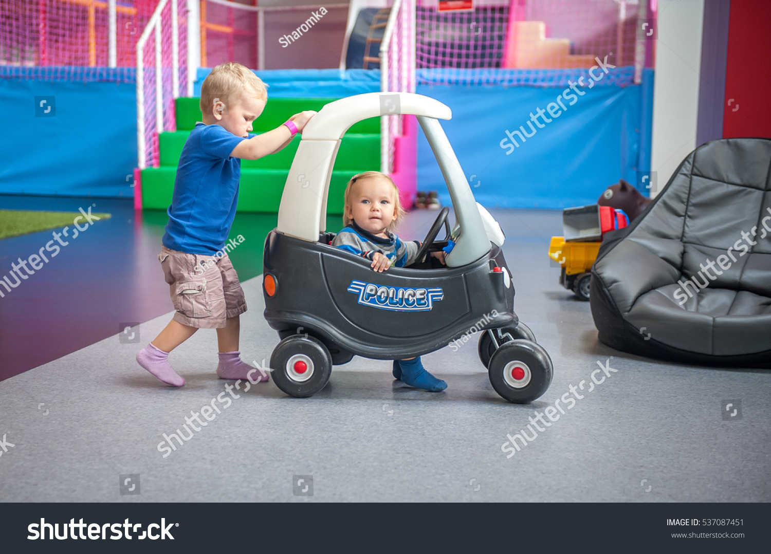Toys For Kindergarten : Baby kid toddler playing driving toy stock photo