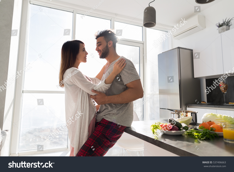 Young Couple Embrace Kitchen Hispanic Man Stock Photo (Royalty Free ...