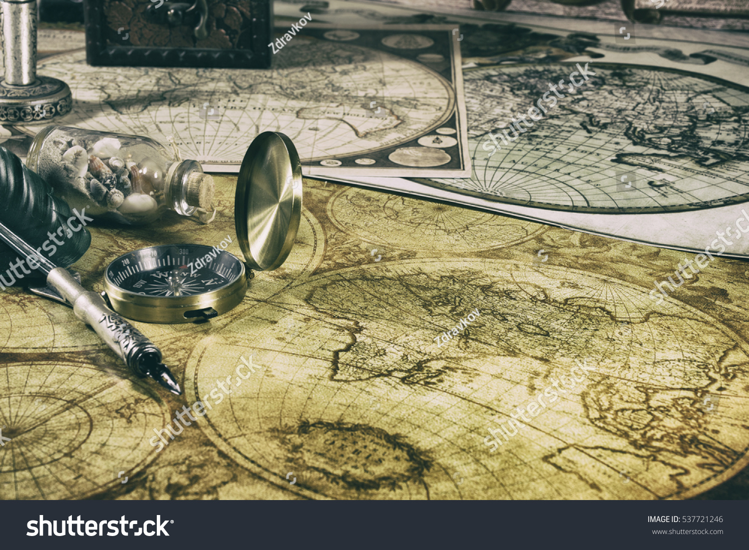 Old compass fountain pen on ancient stock photo 537721246 old compass fountain pen on ancient maps of the world nautical items sciox Gallery