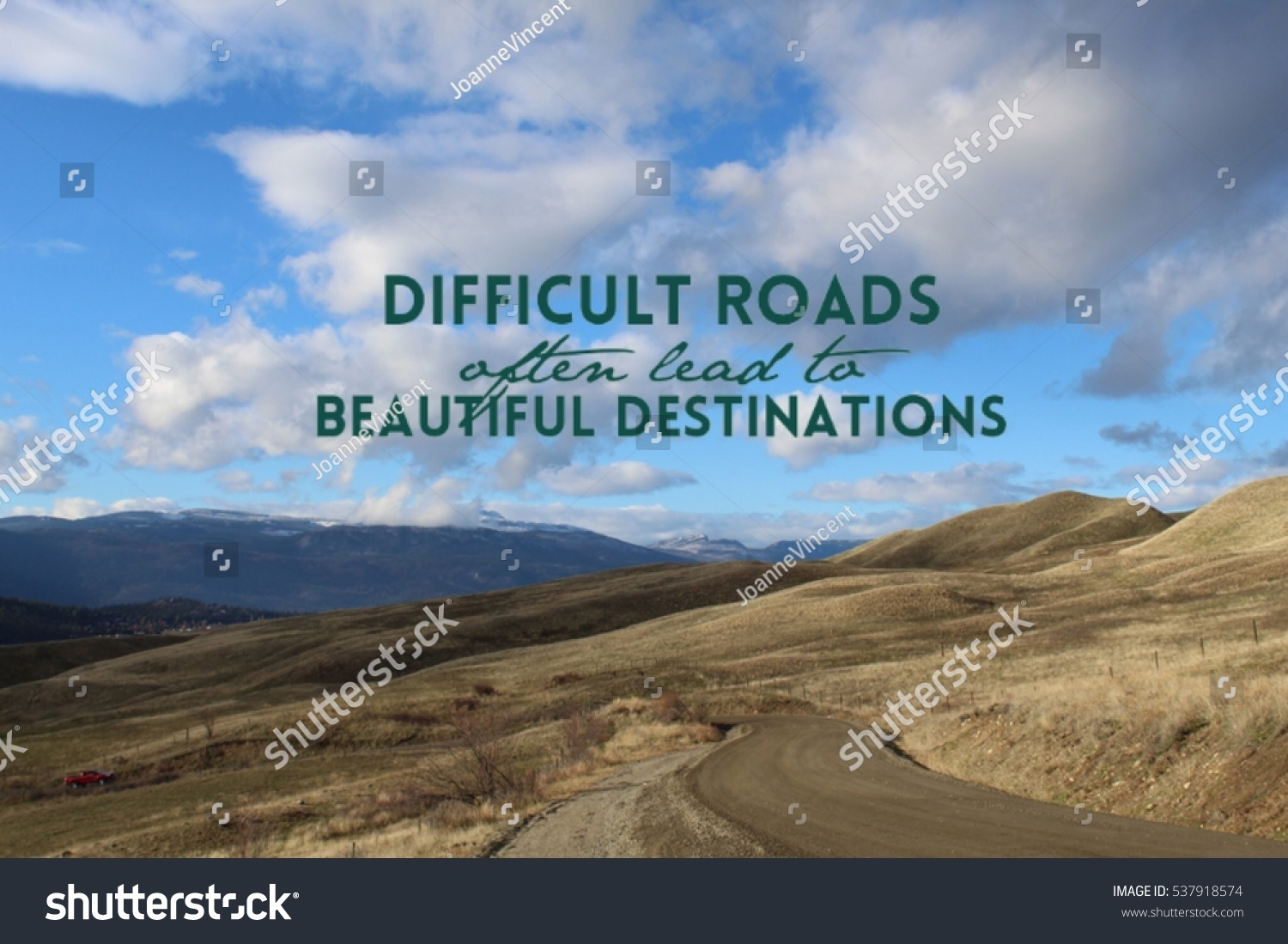 Scenic quotes daily inspirational quotations and sayings on - Inspirational Quote On Scenic Mountain Landscape View With Gravel Road Along Barren Fields And Hills In