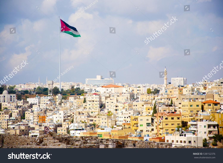 stock-photo-jordan-flag-in-amman-5381523