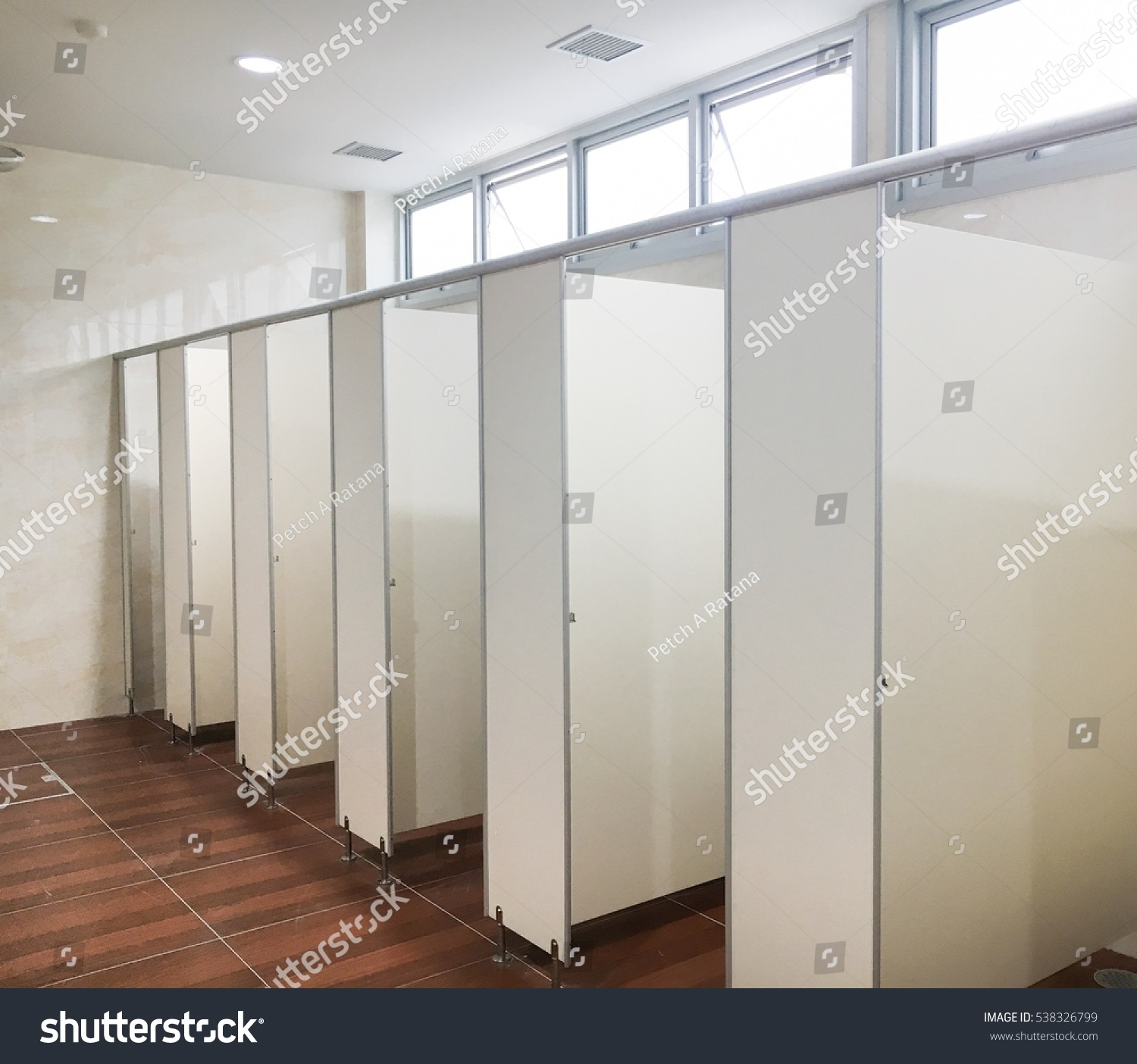 New toilet room white particle board stock photo 538326799 new toilet room white particle board for room wall brown ceramic tiles for floor dailygadgetfo Gallery
