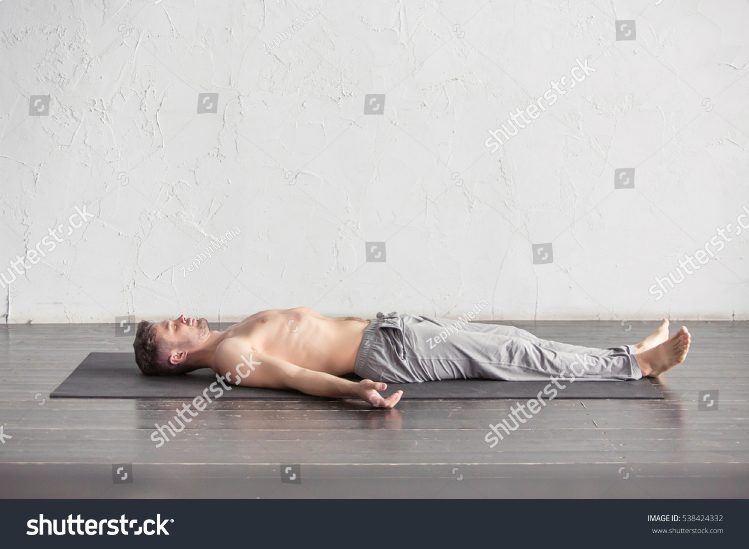 Yoga young men meditating on wooden stock photo 538424332 for Floor yoga poses