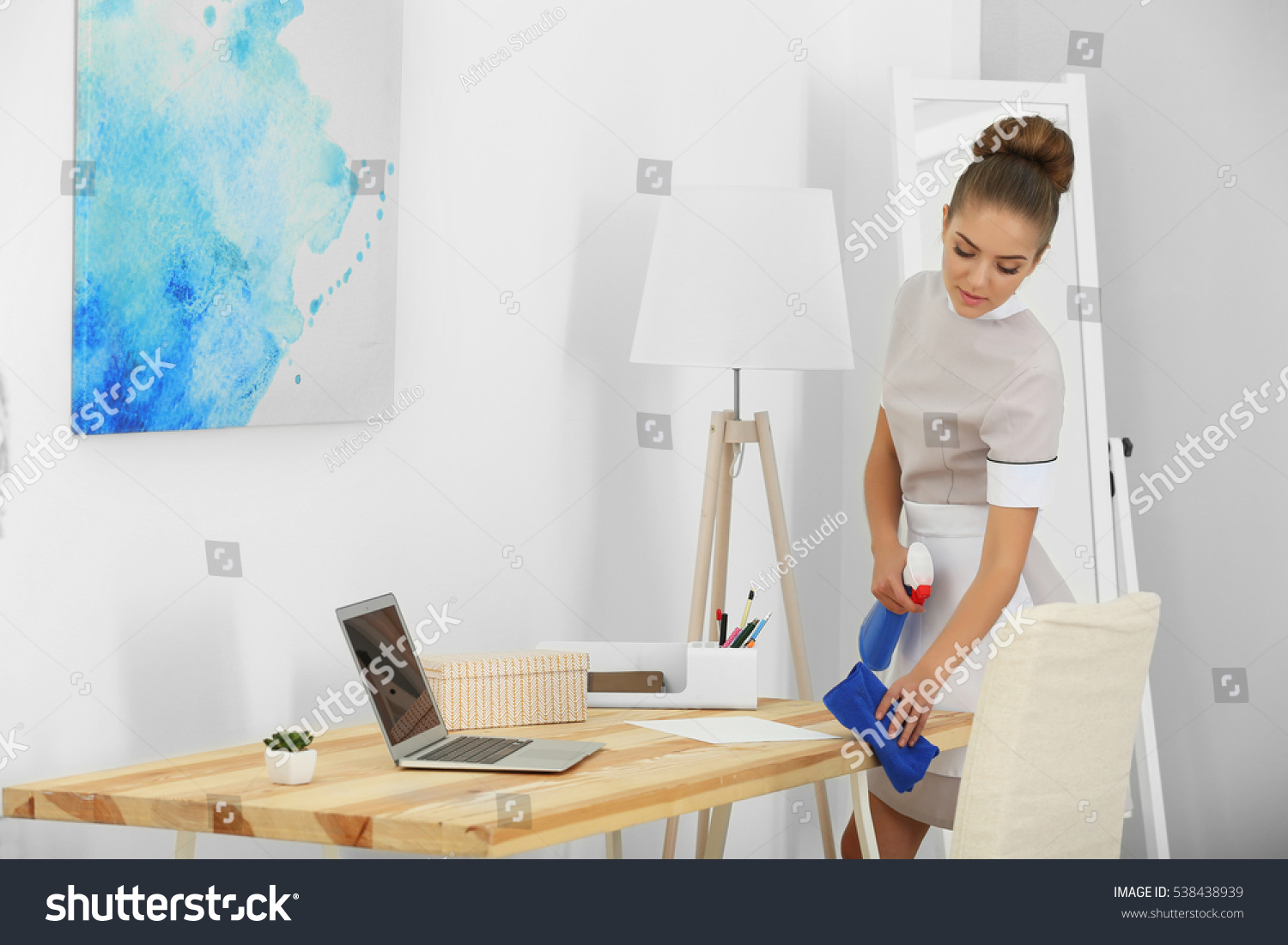 Best Way To Dust Furniture Concept hotel service concept chambermaid cleaning table stock photo