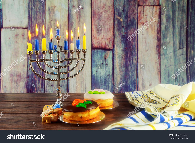 Jewish symbol jewish holiday hanukkah menorah stock photo jewish symbol jewish holiday hanukkah with menorah traditional candelabra and wooden dreidels spinning top glitter biocorpaavc Image collections