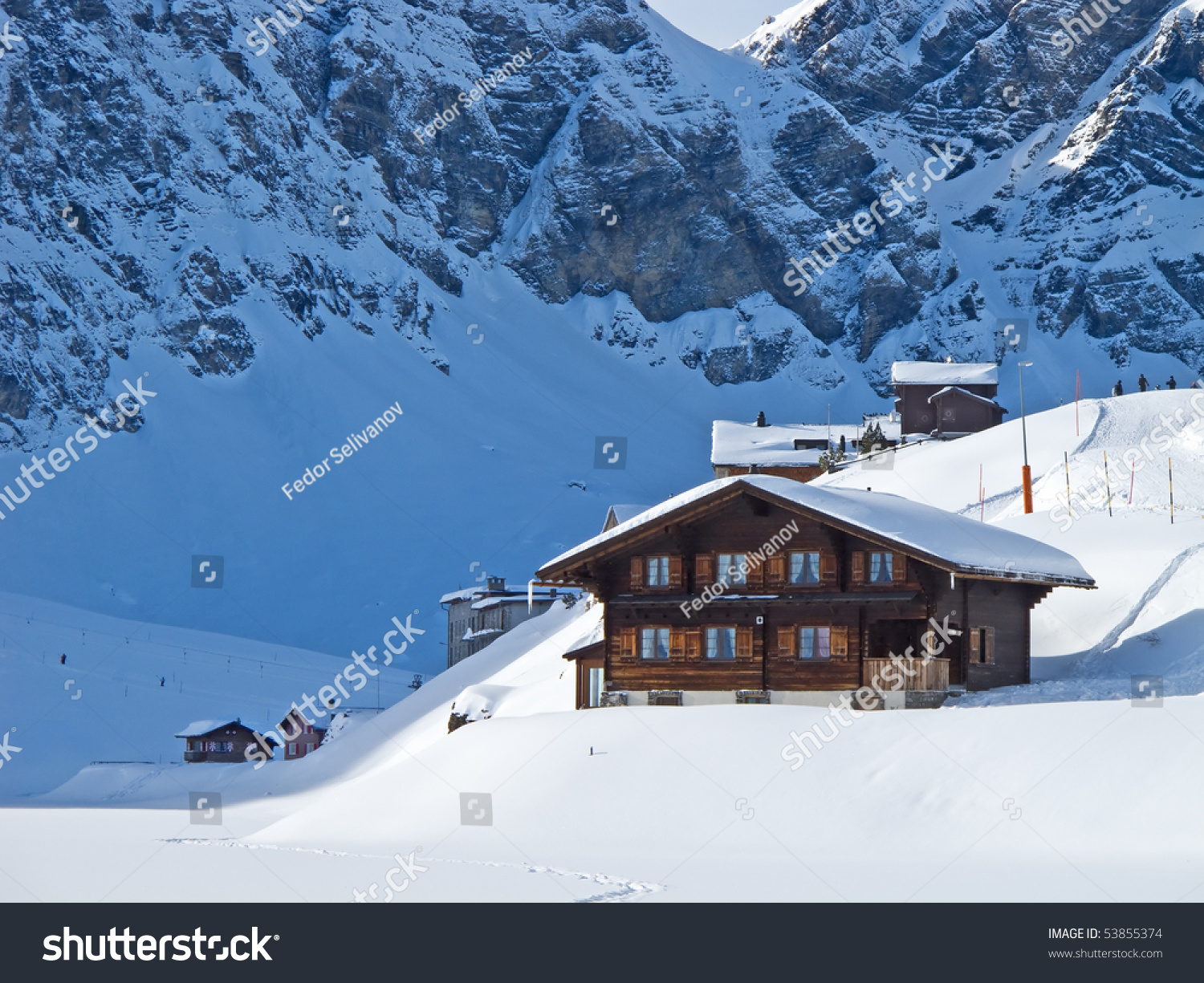 Winter Holiday House In Swiss Alps Stock Photo 53855374