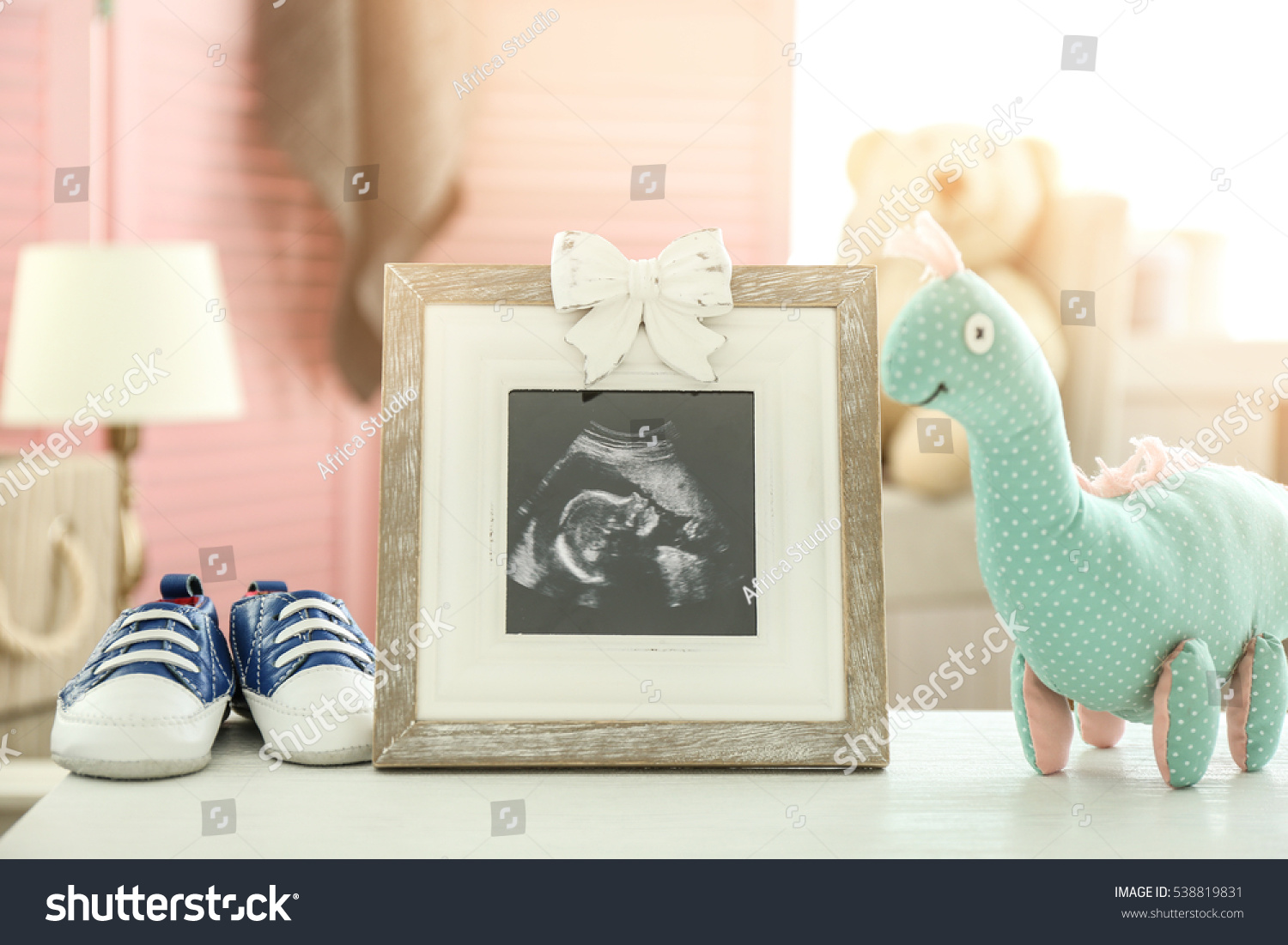Frame ultrasound photo toy baby shoes stock photo 538819831 frame with ultrasound photo toy and baby shoes on table jeuxipadfo Image collections