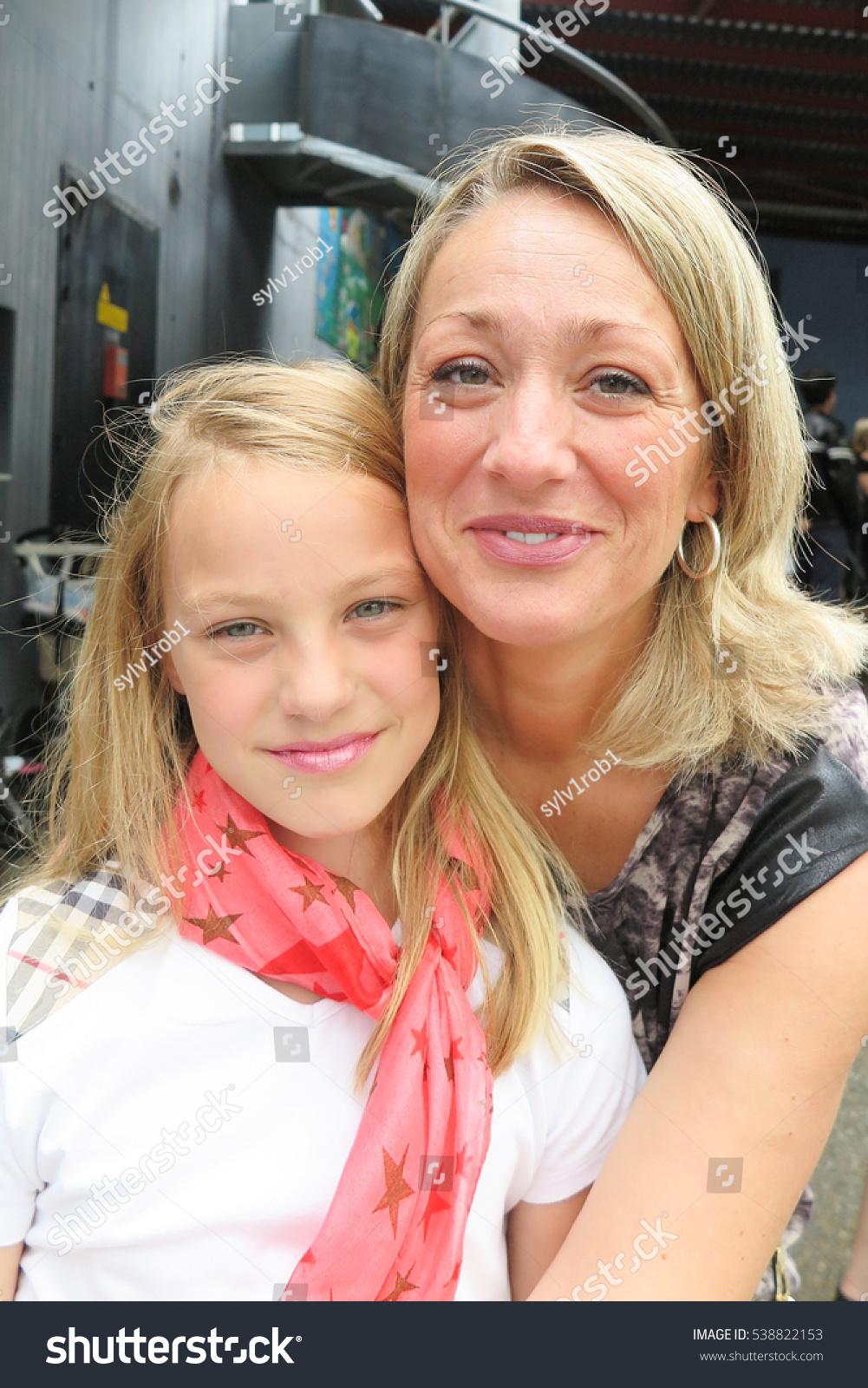 portrait of blonde family, mother daughter hug