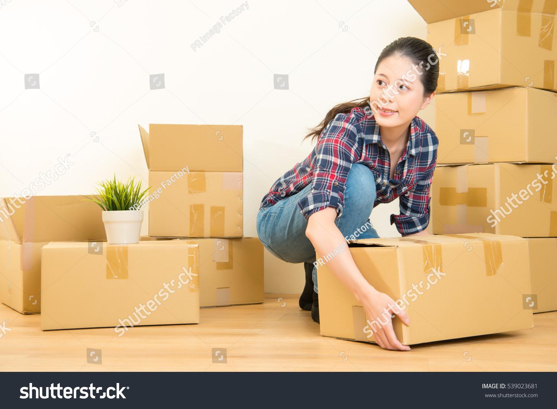 Asian Women Holding Things
