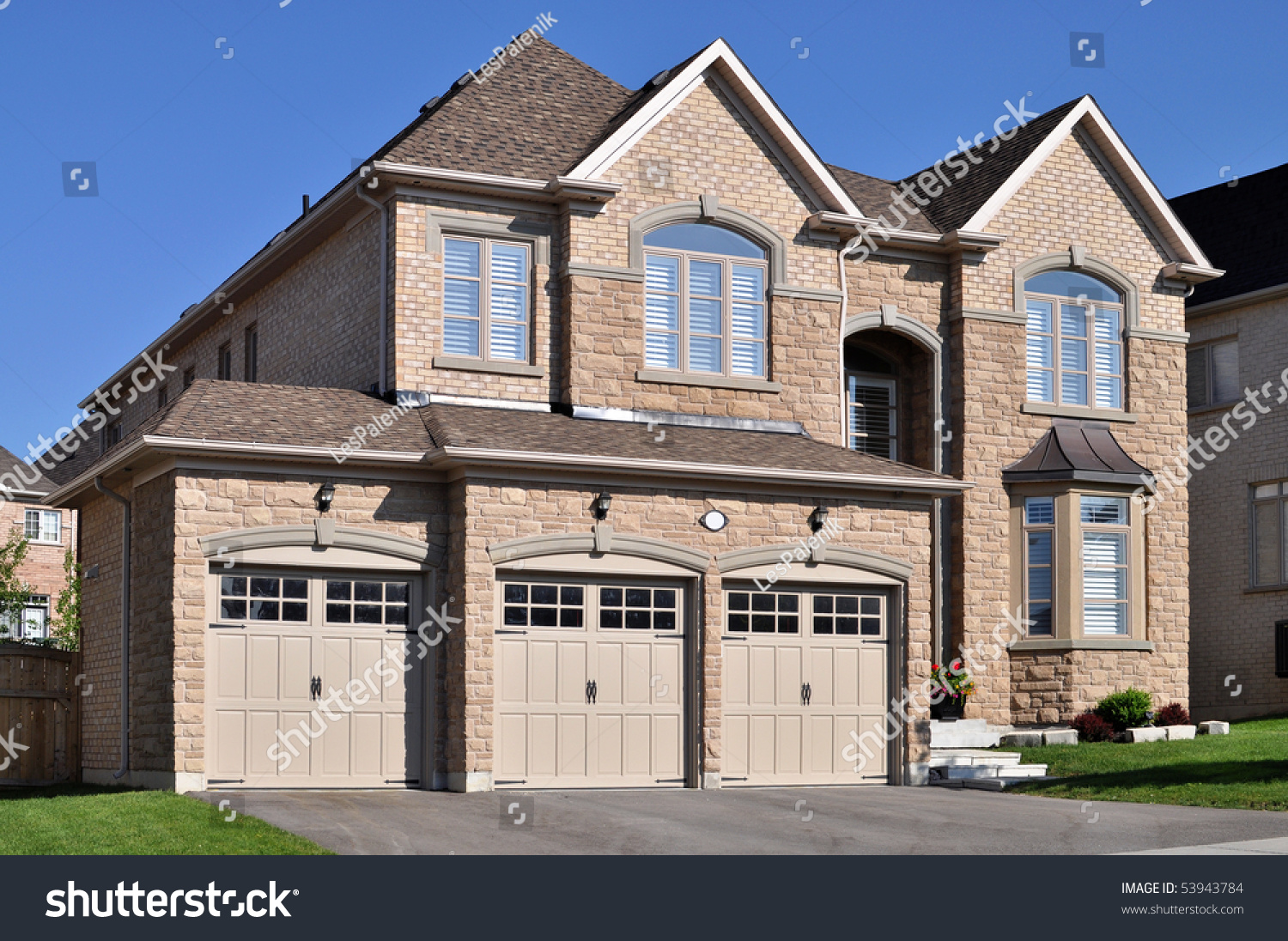 New brick house triple garage stock photo 53943784 for New brick homes