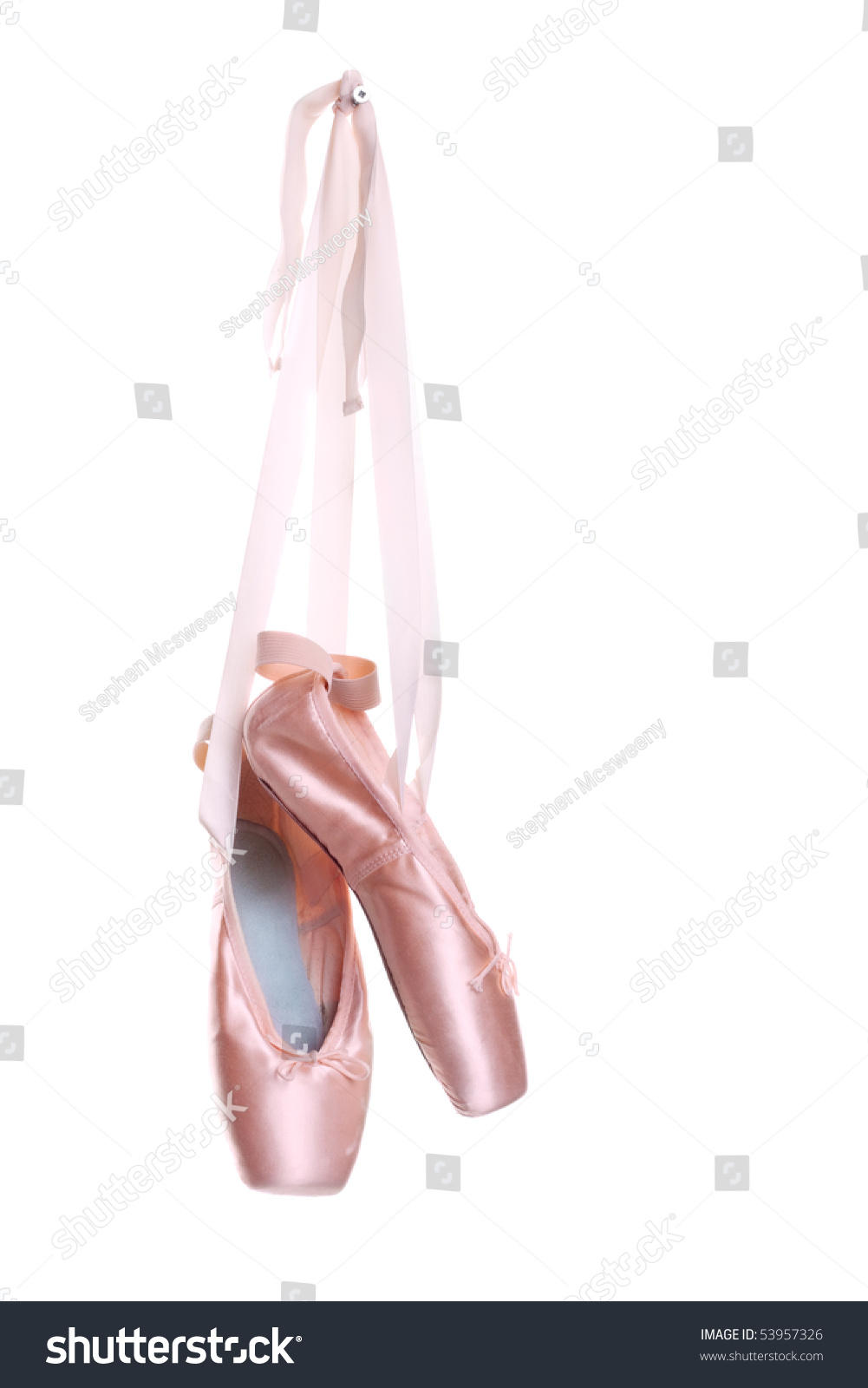hanging pink ballet shoes isolated on stock photo 53957326