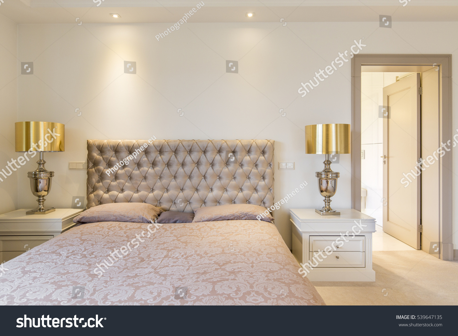 Elegant Master Bedroom Double Bed Quilted Stock Photo