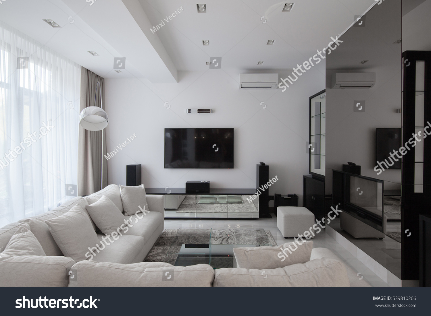 White modern apartments with air conditioning and TV and long-transparent curtains #539810206