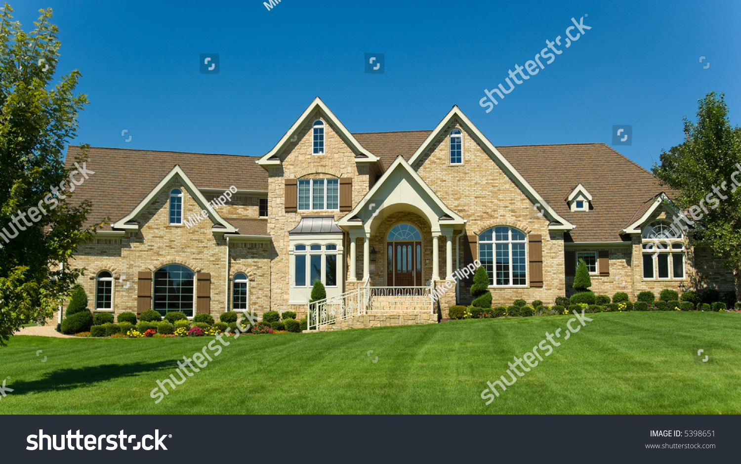 Beautiful two story home landscaped yard stock photo for Beautiful two story homes