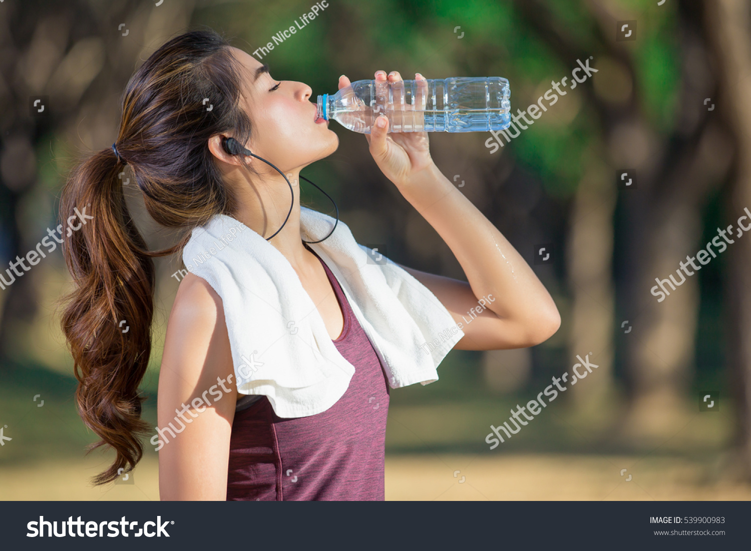 asian young woman drinking water after stock photo