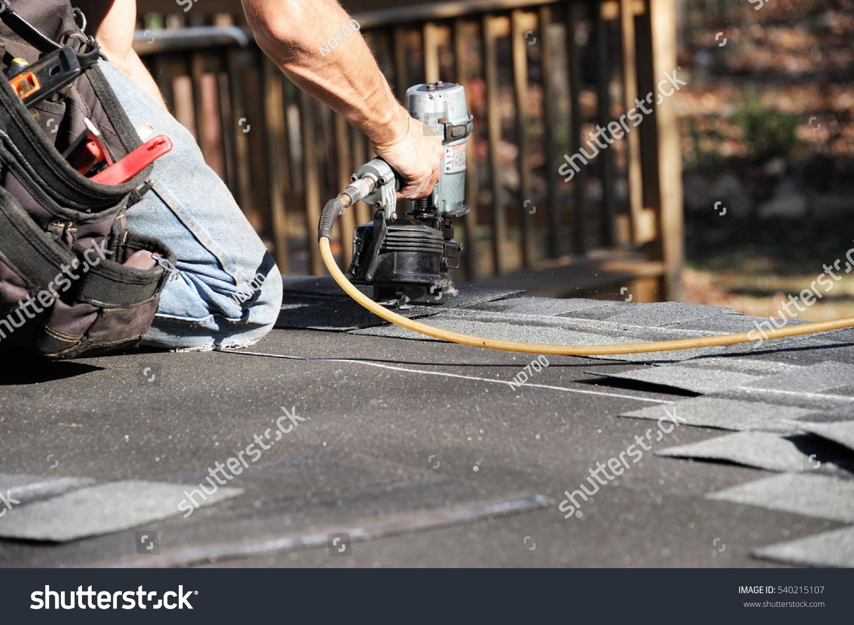Handyman Using Nail Gun Install Shingle Stock Photo (Safe to Use ...