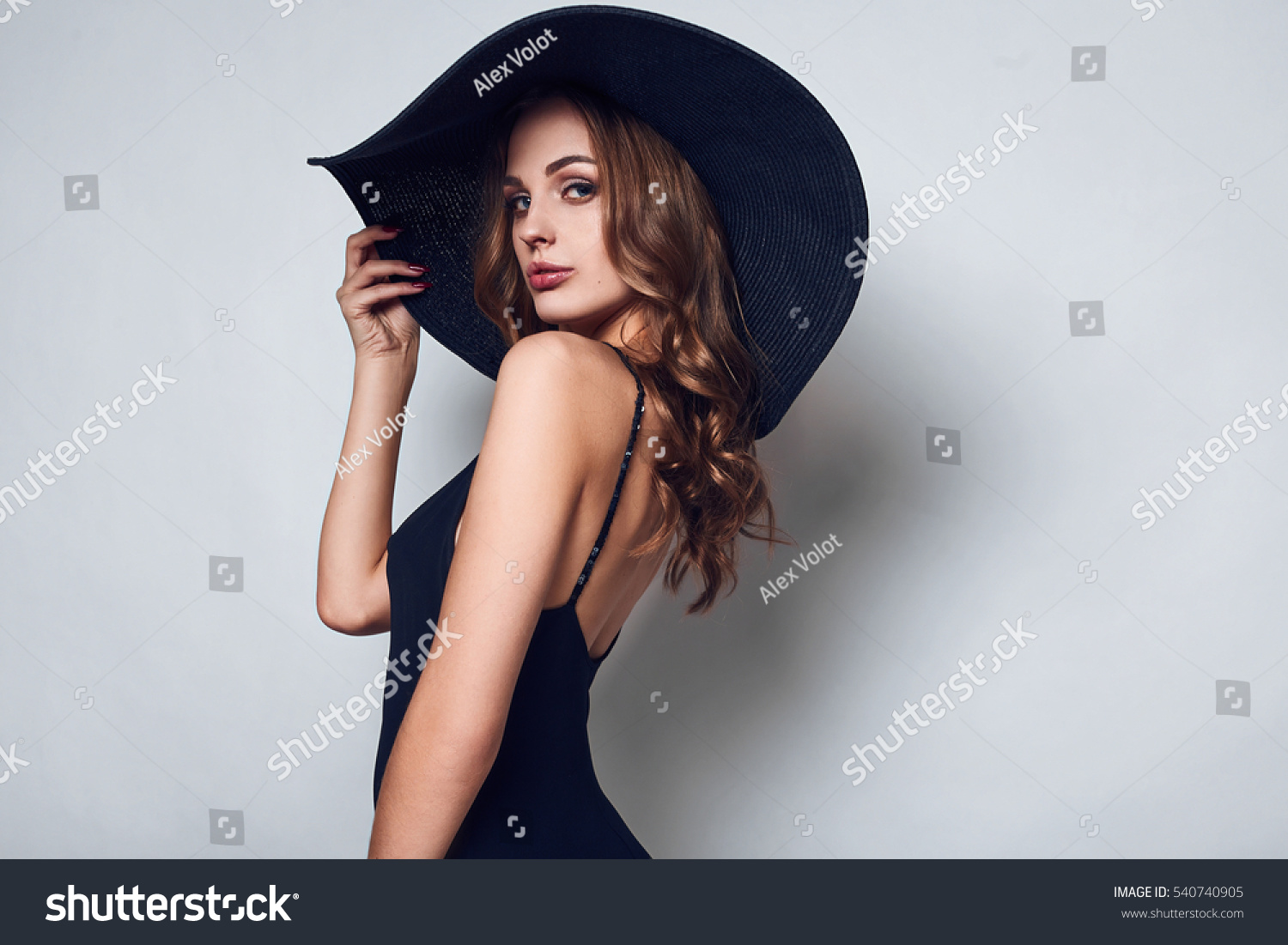 Black dress woman - Portrait Of Elegant Beautiful Woman In A Black Dress And Wide Hat Isolated On White Background