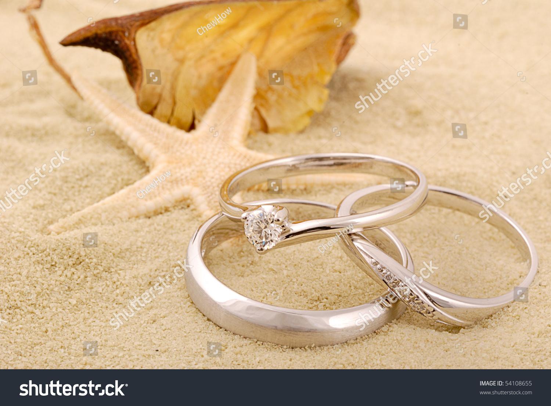 Three Wedding Rings On Sand Stock Photo 54108655 Shutterstock