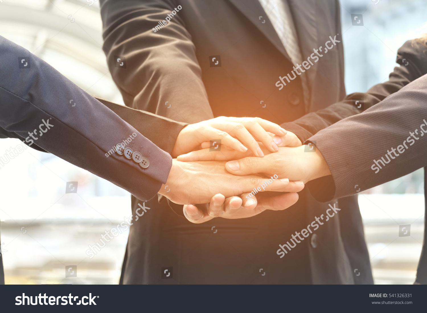 Technology Management Image: Business Concept, Business Team Hold Hands Together Stock