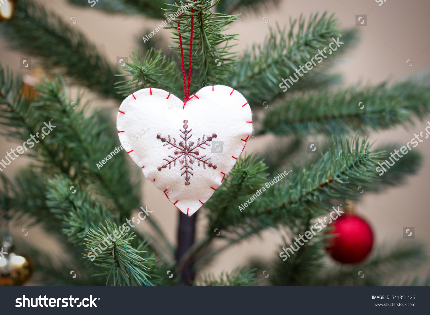 Decorated christmas tree handmade felt heart stock photo