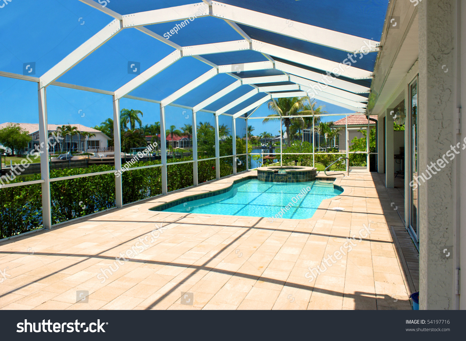 Wide Angle View Of Screened In Pool And Lanai In Florida
