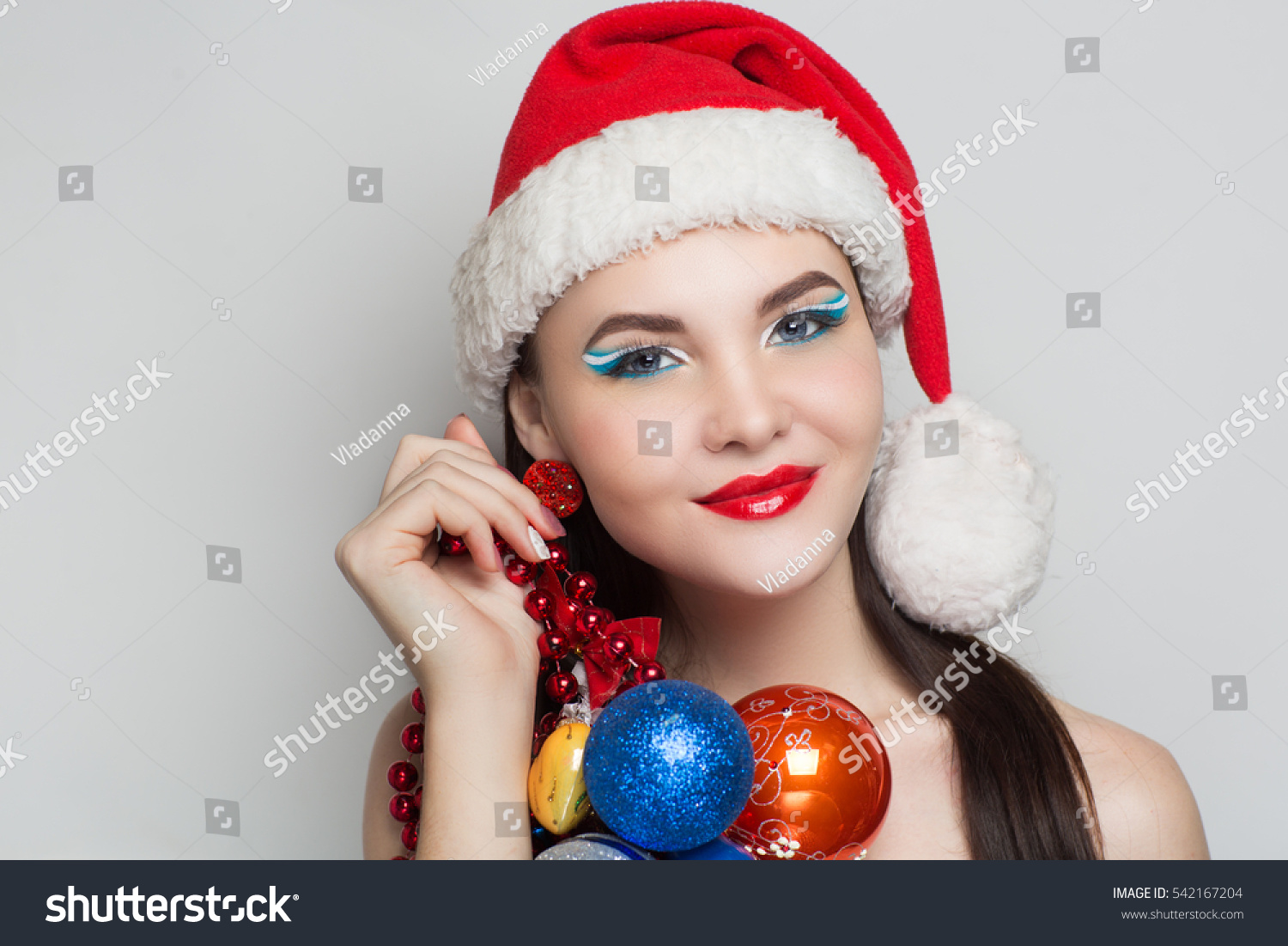 5a19739413620 Young face close up photo portrait. Beautiful girl wearing Christmas red hat  cap. Pretty woman smile happy emotions