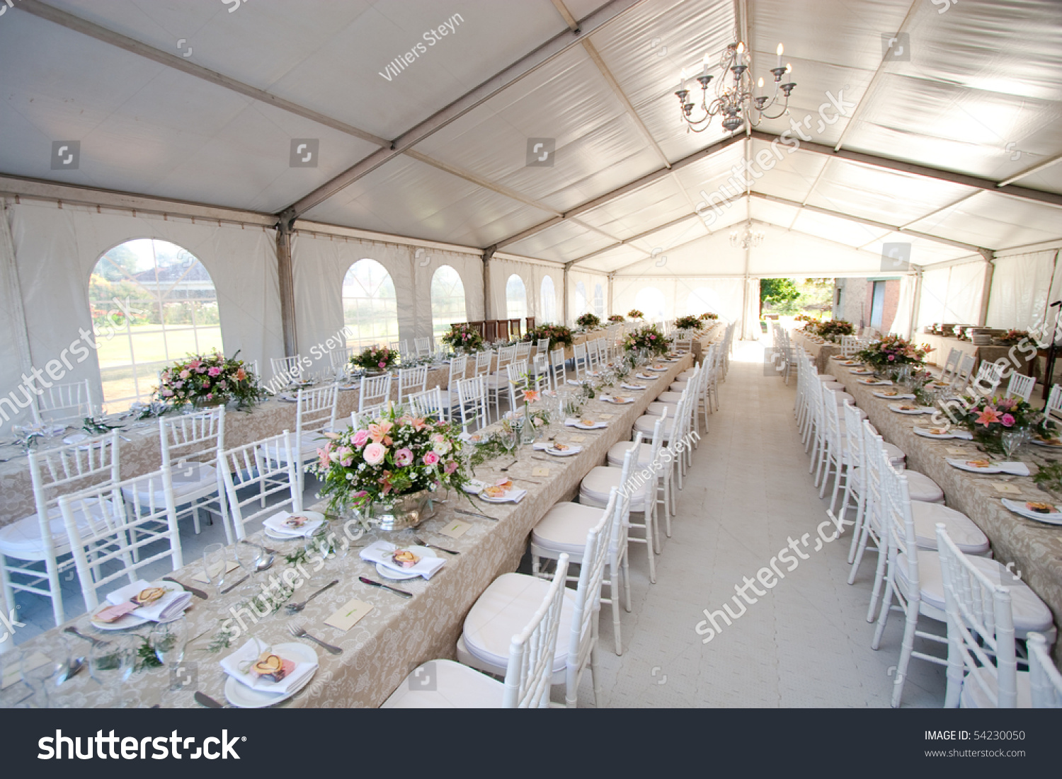 White Chairs At A Wedding Indoor Stock Photo: Inside Massive White Wedding Tent Tables Stock Photo