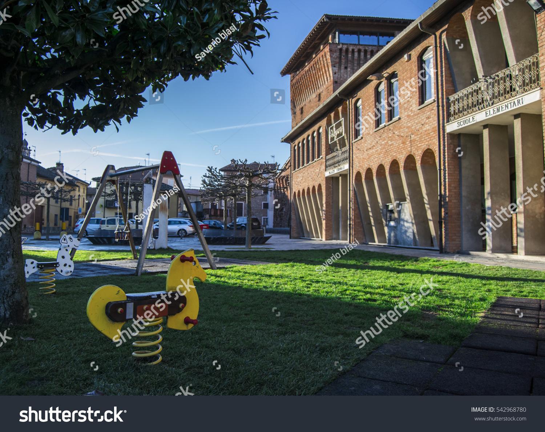 elementary school playground small italian countryside stock photo