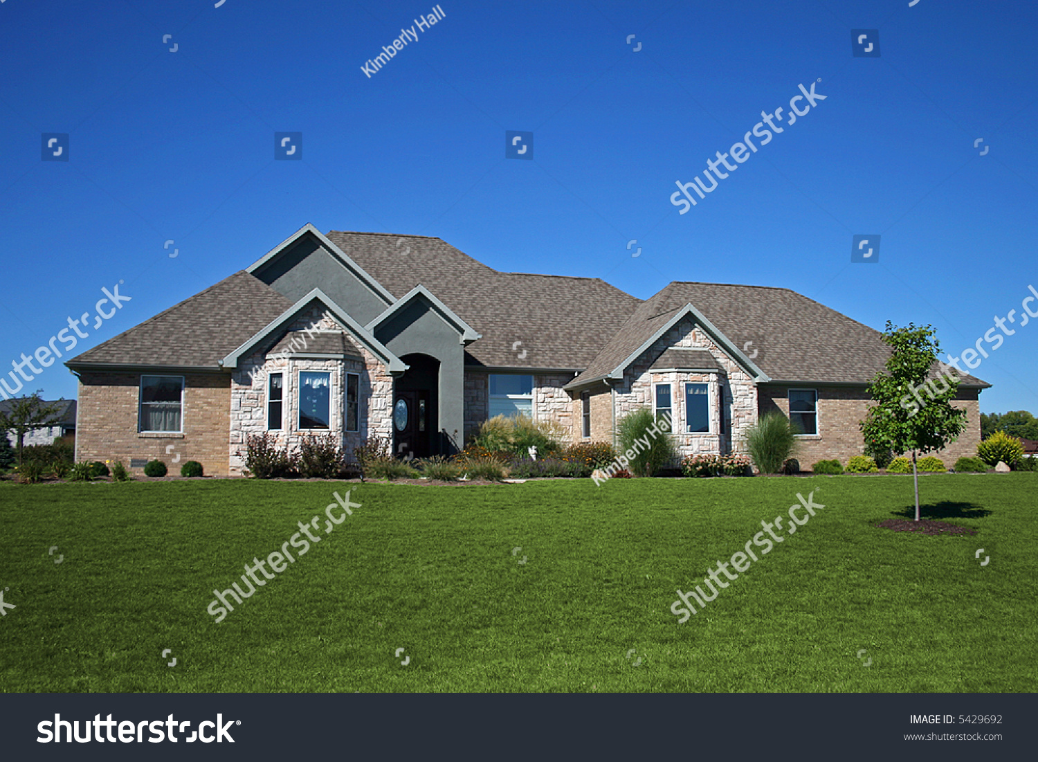 Brick ranch stone accents stock photo 5429692 shutterstock for Houses with stone accents