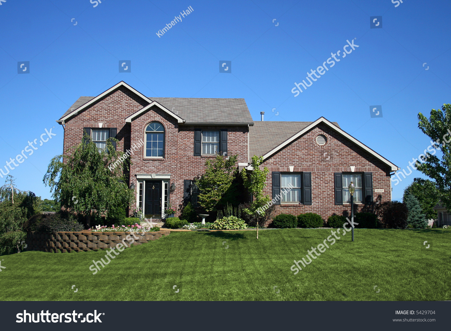 Beautiful brick twostory house stock photo 5429704 for Pretty two story houses