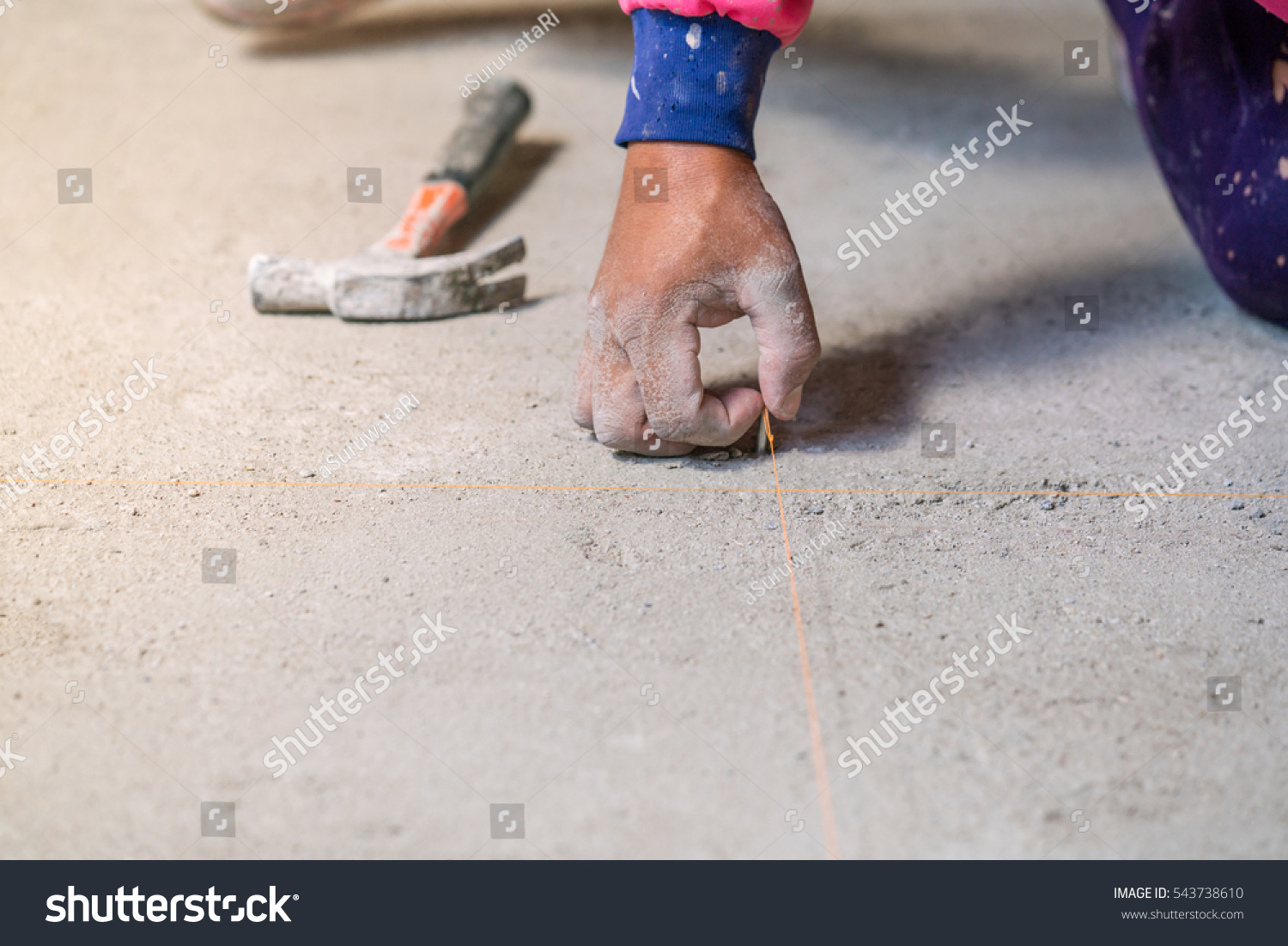 Hand hold nail hit on concrete stock photo 543738610 shutterstock hand hold nail hit on concrete floor for plane laying ceramic tiles installing tiles in dailygadgetfo Choice Image