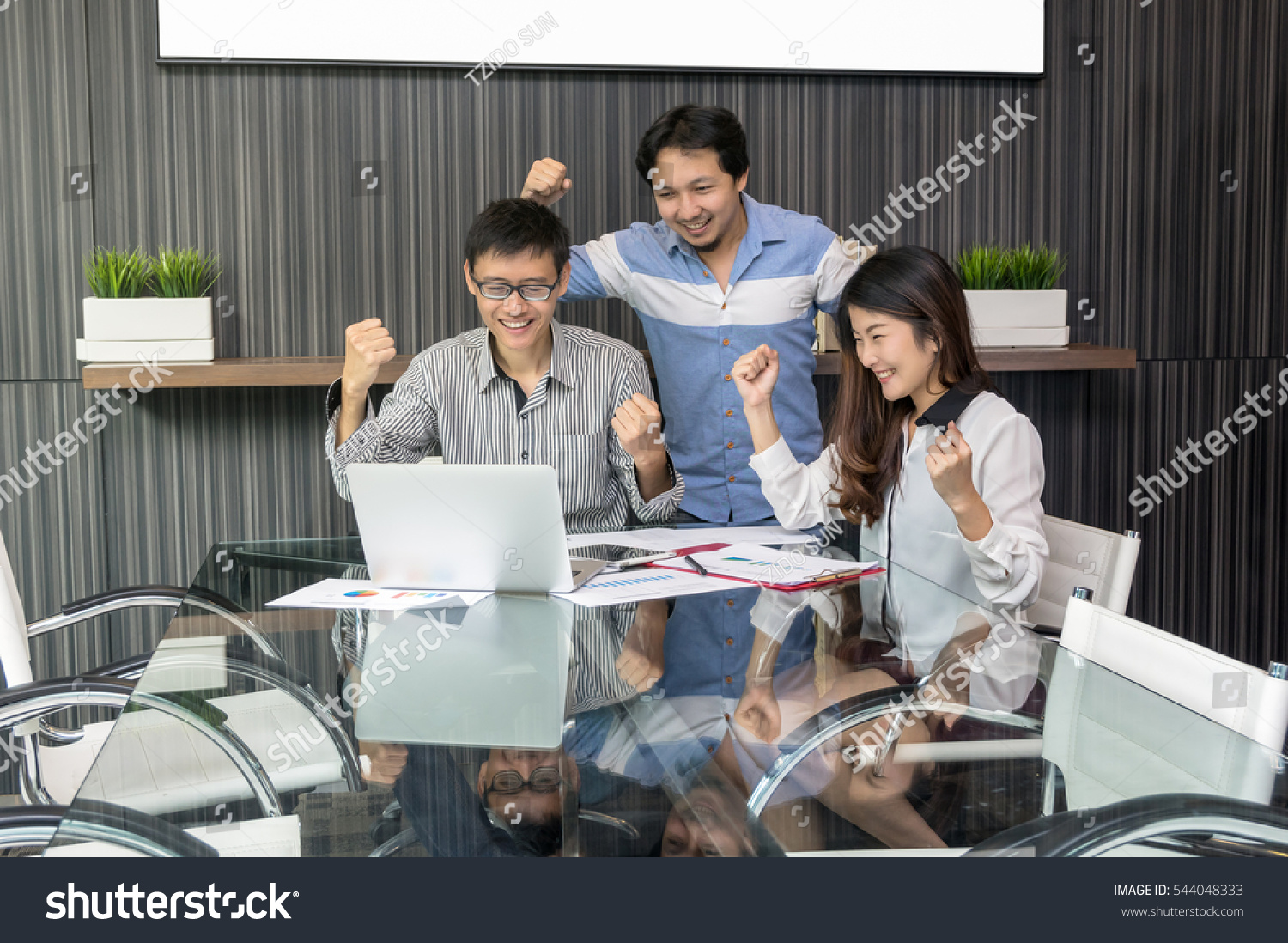 Group Of Asian Business people with casual suit working with happy action in the modern meeting room business group concept